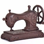 Antique sewing machine isolated