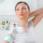 Woman doing exercise wearing smart wearable device with futurist